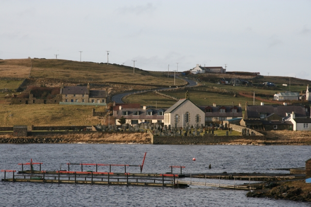 Image of Walls Kirk and Cemetery looking across the top of the Harbour